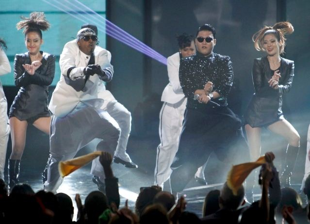 South Korean rapper Psy performs with MC Hammer at the 40th American Music Awards in Los Angeles
