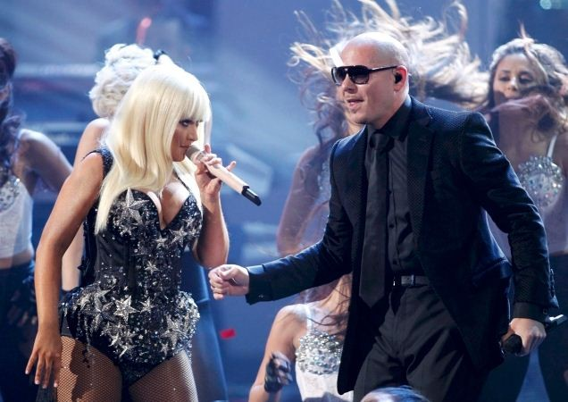 Pitbull and Christina Aguilera perform at the 40th American Music Awards in Los Angeles