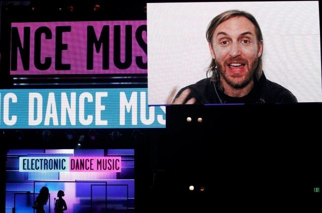 David Guetta accepts the award for favorite electronic dance music artist via taped message at the 40th American Music Awards in Los Angeles