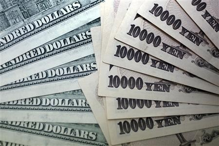 Japanese 10,000 yen notes spread out next to U.S. dollar bills