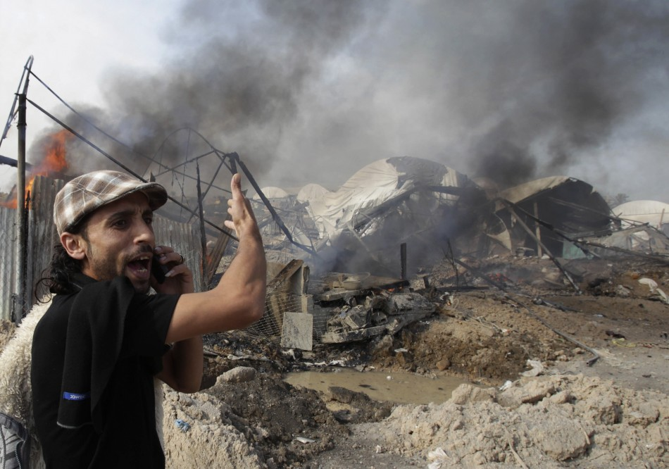 Palestinian shouts in front of what witnesses said are destroyed tunnels after Israeli air strike