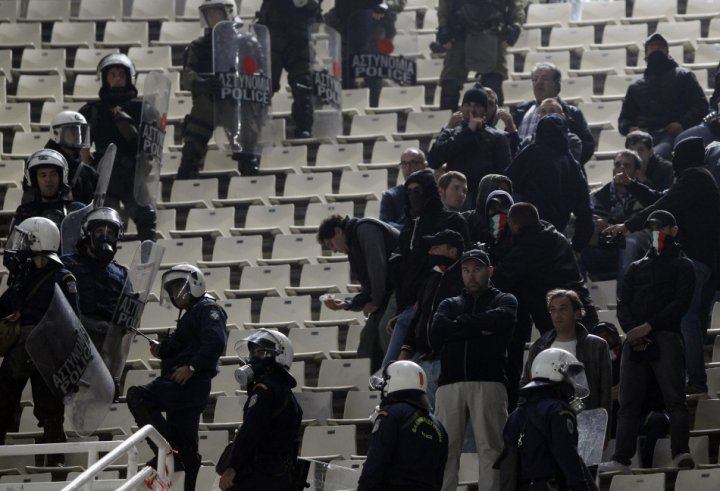 Lazio fans are surrounded by riot policemen during their Europa League Group J soccer match against Panathinaikos