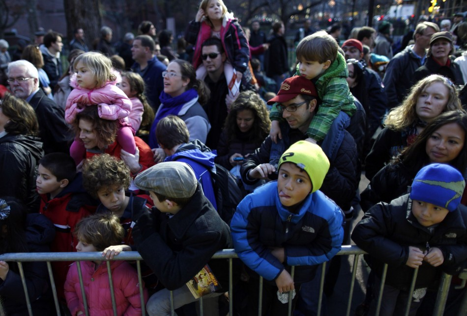 Families with children look at floats ahead of the Macys Thanksgiving Parade in New York
