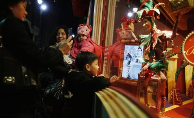 A child looks in the window at the holiday displays at Macys department store in New York
