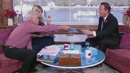 Cameron is handed list by Schofield live on air