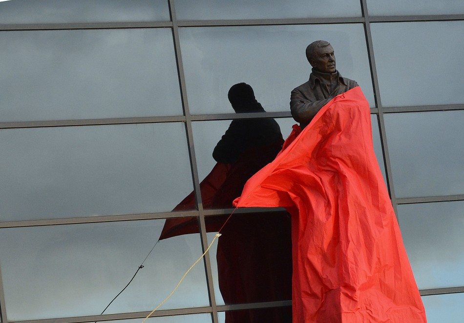 A statue of Manchester United manager Alex Ferguson, by sculptor Philip Jackson, is unveiled at Old Trafford (Reuters)