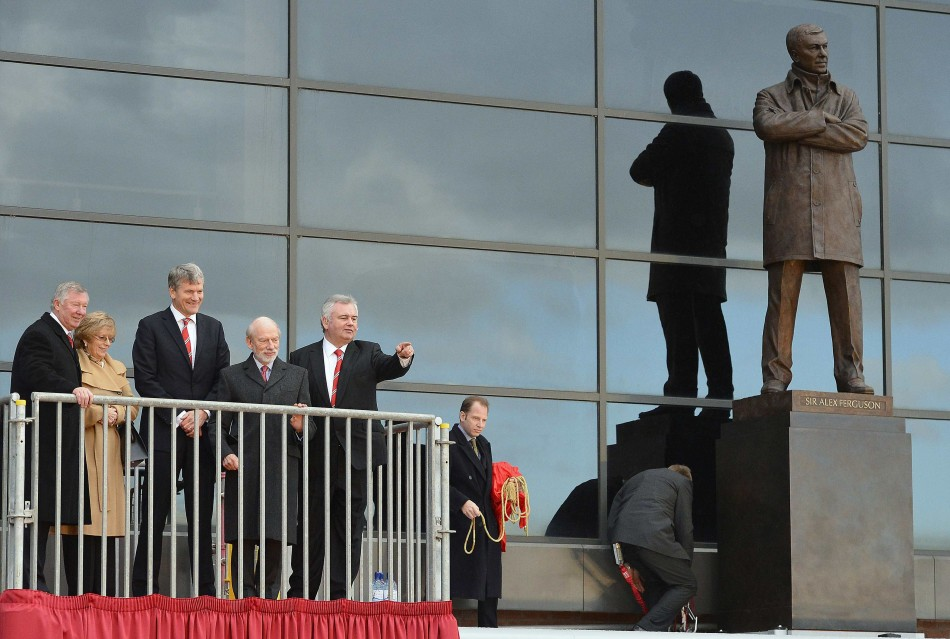 Ferguson at the unveiling of his sculpture at Old Trafford