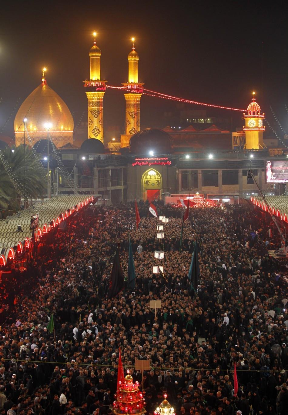 Shi'ite pilgrims gather at the Imam Abbas shrine