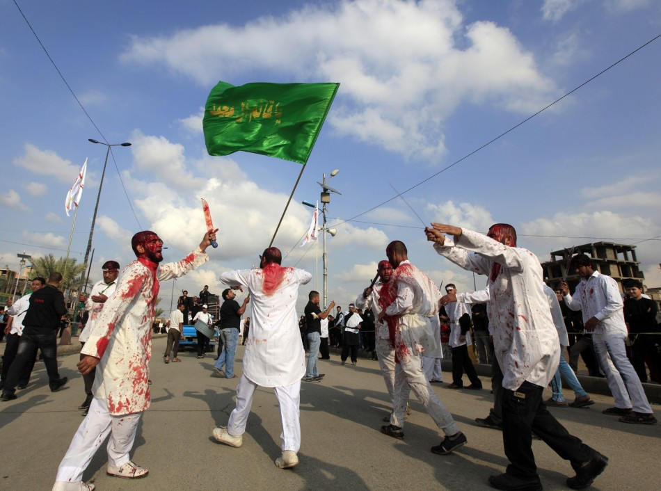 Shiite Iraqi men covered in blood take part in the Ashura procession in Baghdad