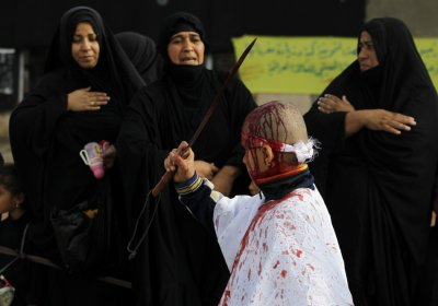 An Iraqi Shiite Muslim child gashes his forehead with a sword during a ceremony marking Ashura in Baghdad