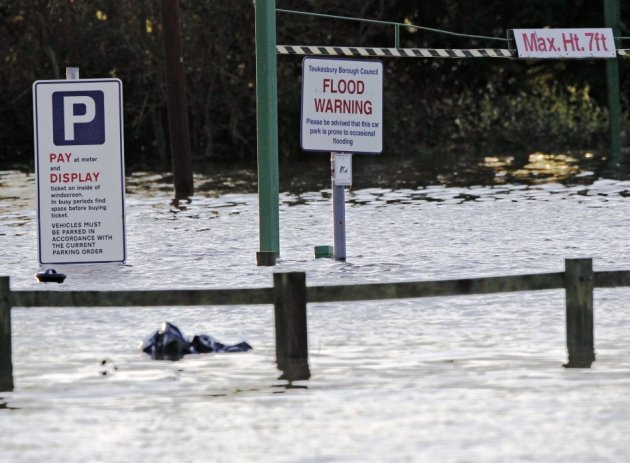 A sign in a car park warns of occasional flooding in Tewkesbury (Reuters)