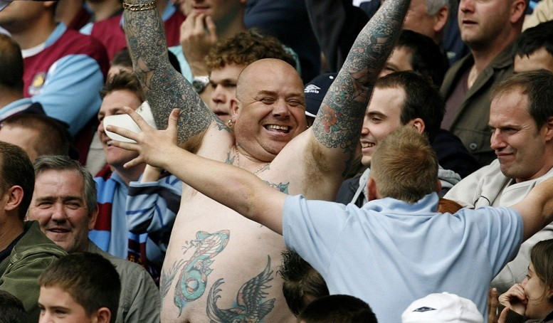 Happier times: West Ham fans cheer w win against Bolton Wanderers.