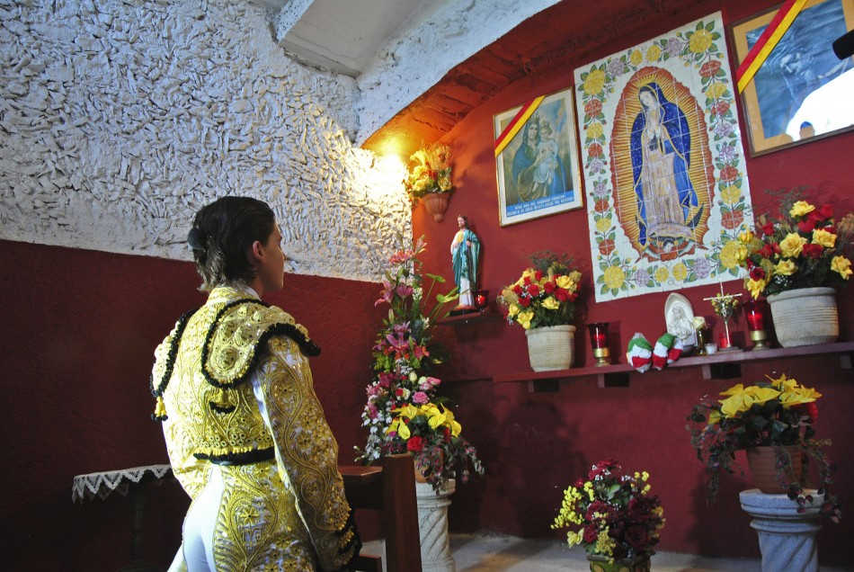 Mexican bullfighter Michelito Lagravere prays in a chapel at the Plaza Monumental bullring in Merida