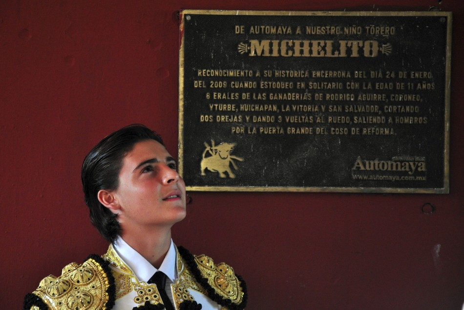 Mexicos bullfighter Michelito Lagravere poses next to a plaque about him at the Plaza Monumental bullring in Merida