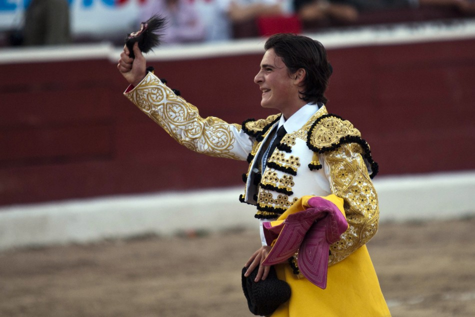 Mexican matador Michelito Lagravere holds up the ear he received for killing a bull