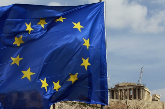 A European Union flag is seen in front of the Parthenon temple in Athens