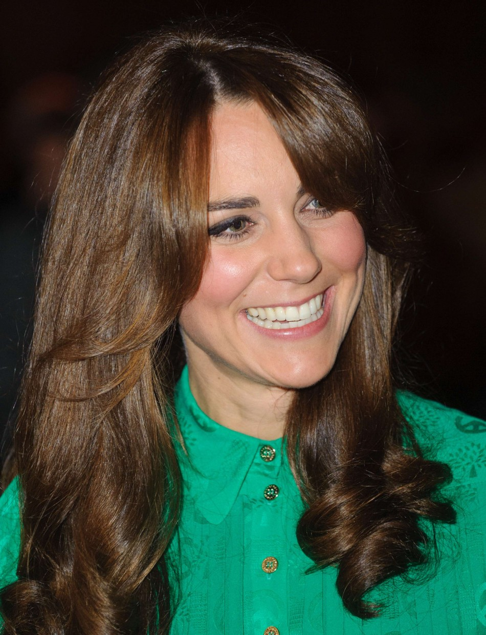 Duchess of Cambridge smiles during a visit to the Natural History Museum where she officially opened the new Treasures Gallery, in central London