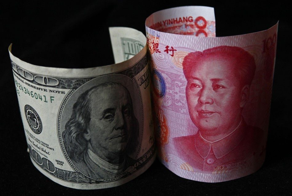A 100 yuan banknote being placed next to a $100 banknote