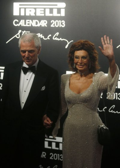 Pirellis President Marco Tronchetti Provera and Italian actress Sophia Loren pose during the arrivals for the launch of the Pirelli Calendar 2013 in Rio de Janeiro
