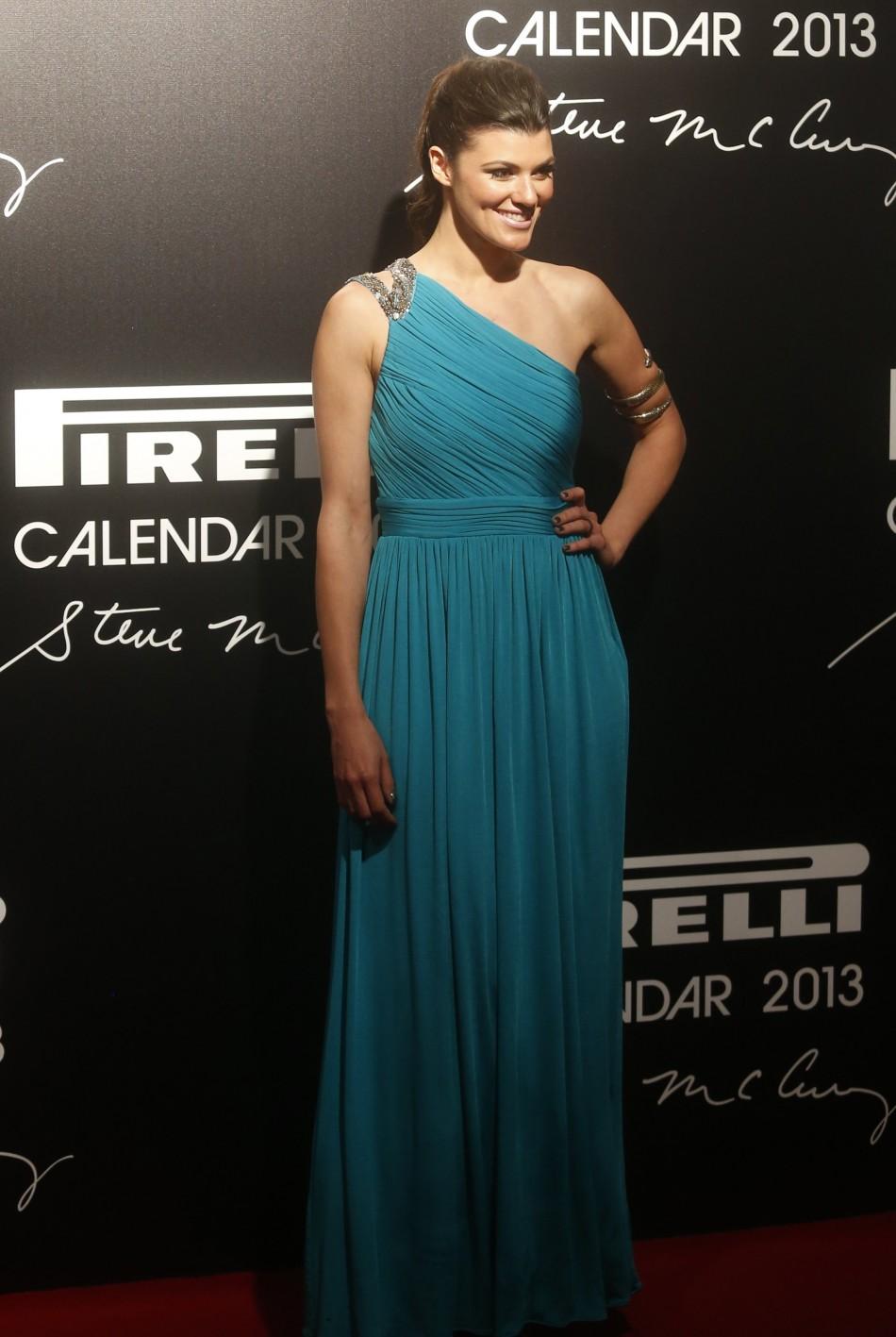 Model Hanaa Ben Abdesslem poses as she arrives for the launch of the Pirelli Calendar 2013 in Rio de Janeiro