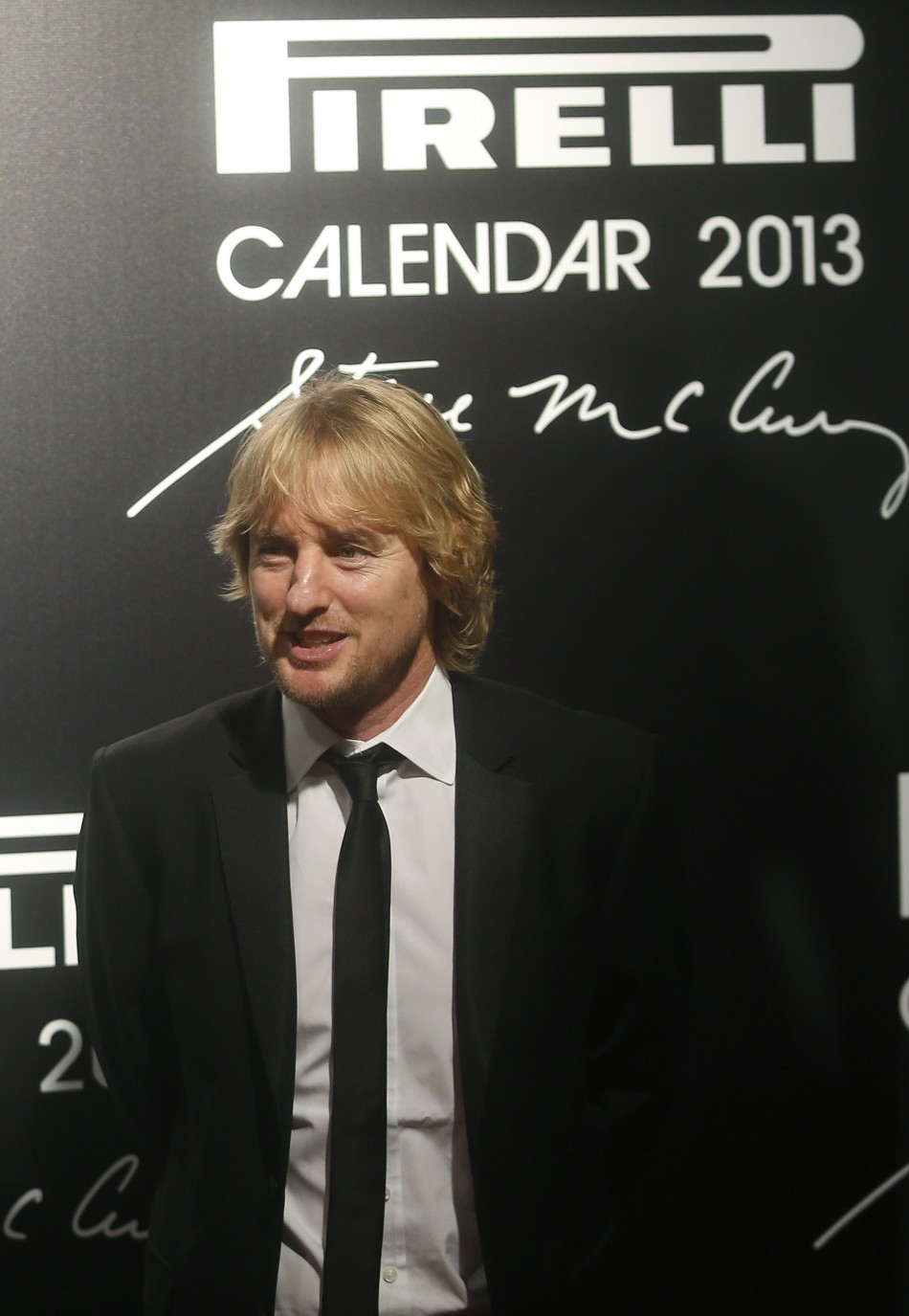 U.S. actor Owen Wilson poses during the arrivals for the launch of the Pirelli Calendar 2013 in Rio de Janeiro