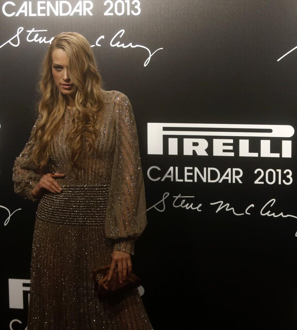 Model Petra Nemcova poses as she arrives for the launch of the Pirelli Calendar 2013 in Rio de Janeiro