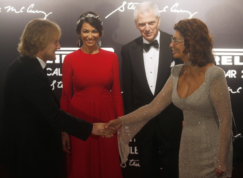 American actor Owen Wilson greets Italian actress Sophia Loren as Afef Jnifen and Pirellis President Marco Tronchetti Provera observe during the arrivals for the launching of the Pirelli Calendar 2013 in Rio de Janeiro