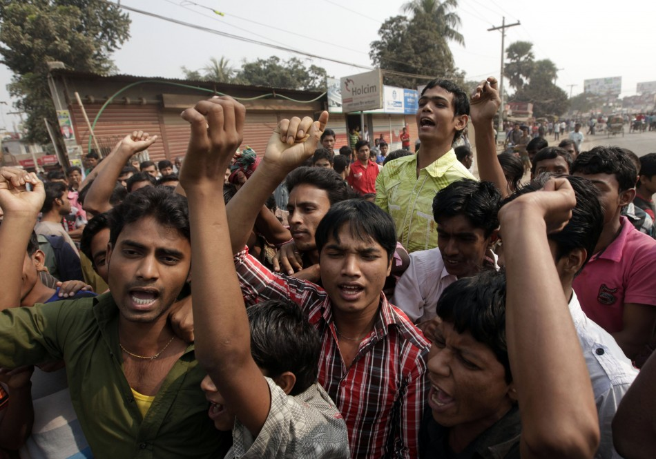 Garment workers chant slogans during a protest against the death of their colleagues in a devastating fire, in Savar