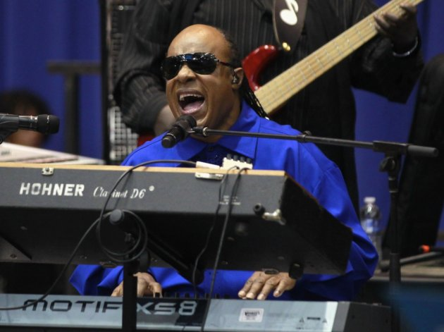 Stevie Wonder sings during an election campaign rally for U.S. President Barack Obama in Cincinnati