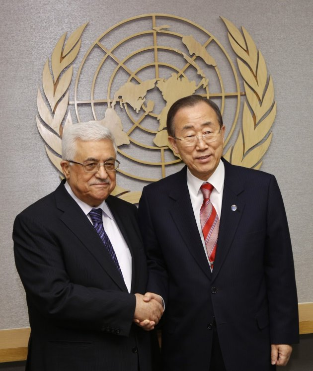 Palestinian President Abbas shakes hands with U.N. Secretary General Ban at the U.N. headquarters in New York