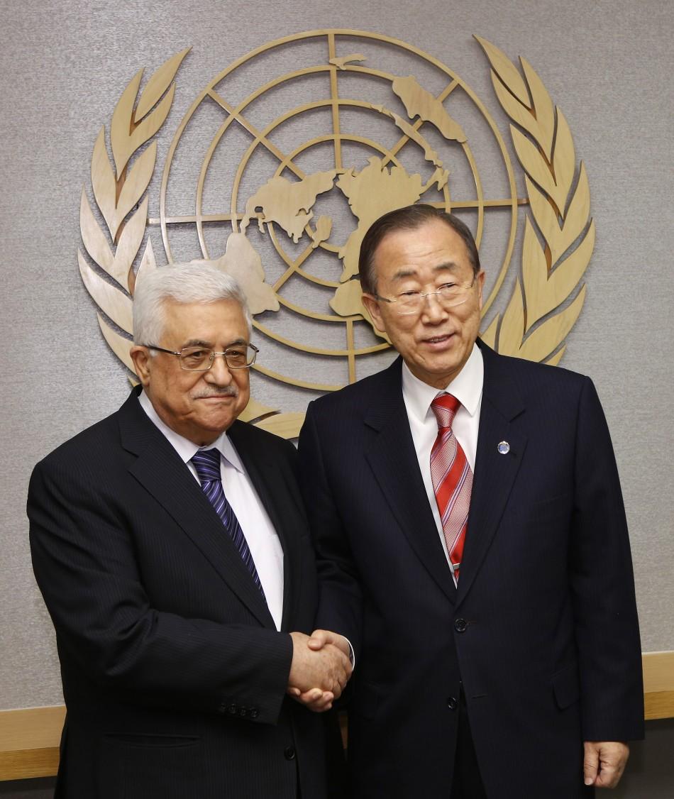 Palestinian President Abbas shakes hands with U.N. Secretary General Ban at the U.N. headquarters in New York