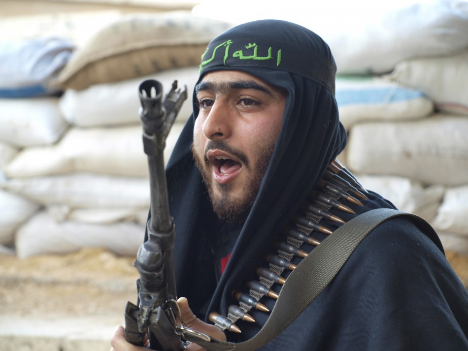 A Free Syrian Army fighter is seen in Daria near Damascus