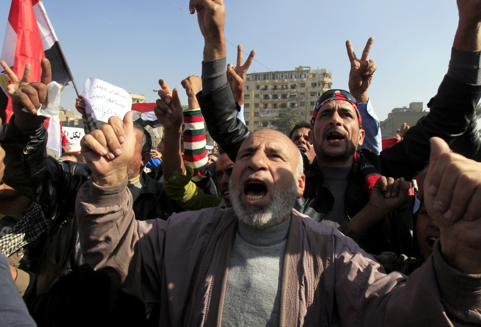Anti-Mursi protesters chant anti-government slogans at Tahrir Square in Cairo
