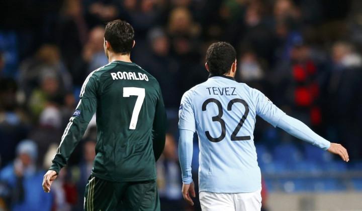 Cristiano Ronaldo and Carlos Tevez (R)