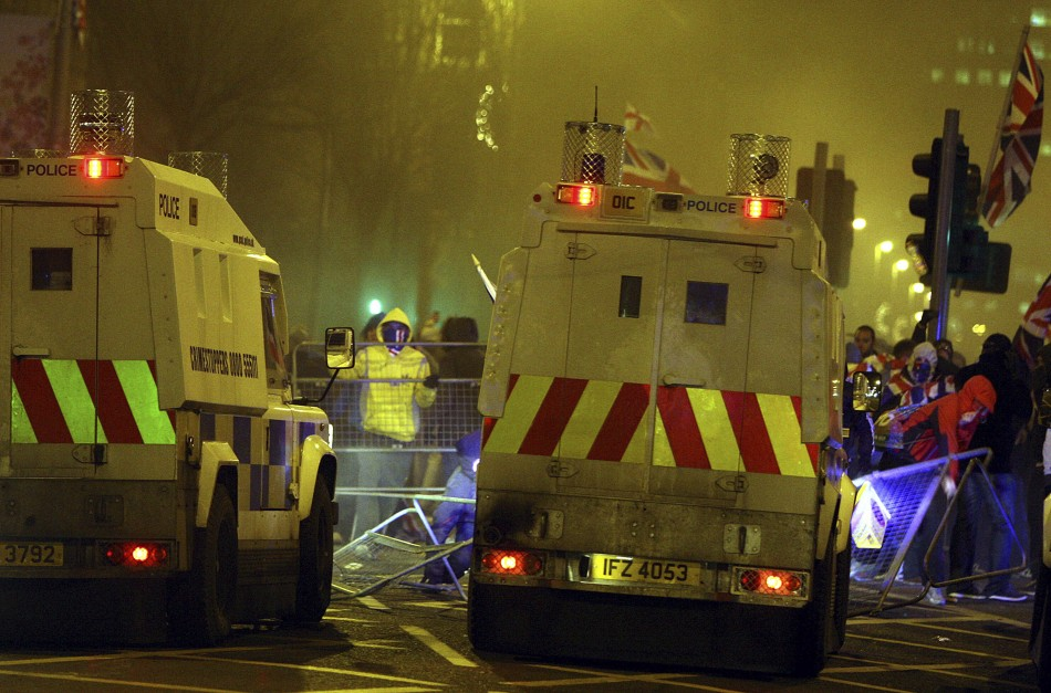 Loyalists clash with police officers outside the City Hall in Belfast (Reuters)