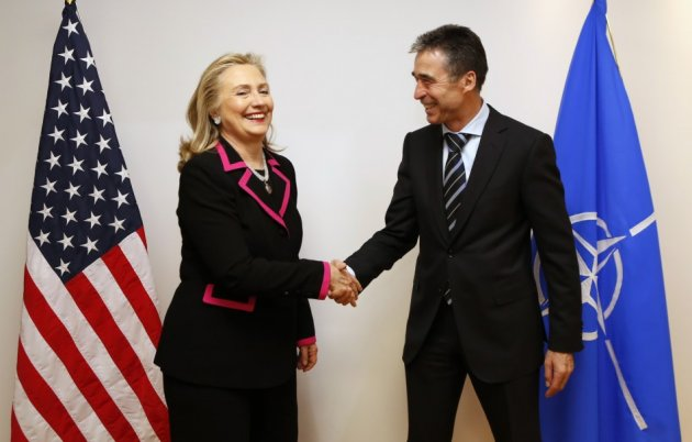 U.S. Secretary of State Hillary Clinton shakes hands with NATO Secretary-General Anders Fogh Rasmusse