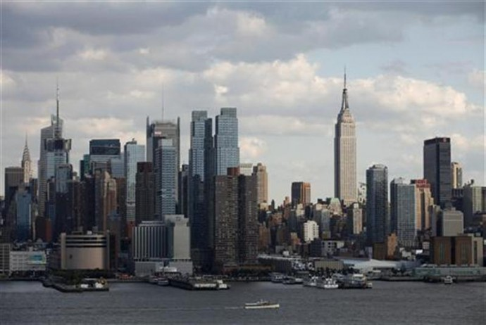 The Empire State Building stands tall on the skyline of midtown Manhattan in New York