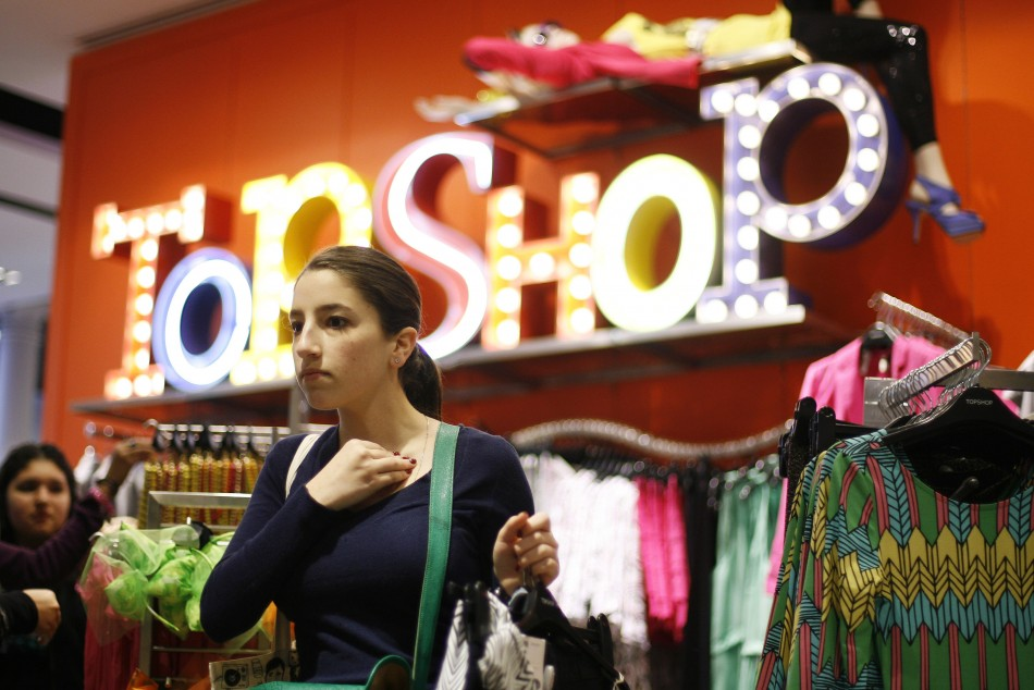 A woman looks at clothing items while shopping in the new Topshop and Topman clothing store in New York (Photo: Reuters)