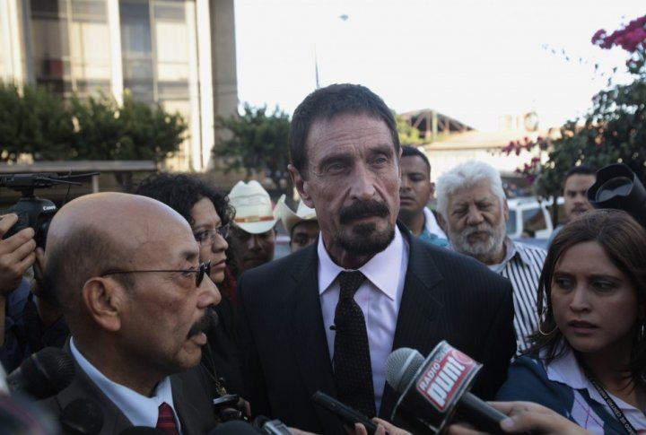 John McAfee attends a news conference with his lawyer Telesforo Guerra outside of the Supreme Court of Justice in Guatemala City