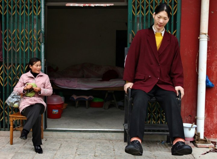 At 7ft 8in, Yao Defen was declared the world's tallest woman (Reuters)
