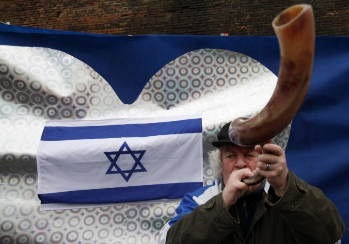 Israeli supporter blows a horn in front of Czech government headquarters in Prague