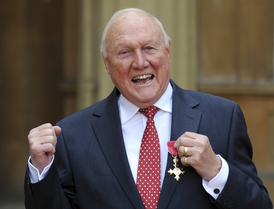 Stuart Hall poses for a photograph after being made an Officer of the British Empire (OBE) (Reuters)