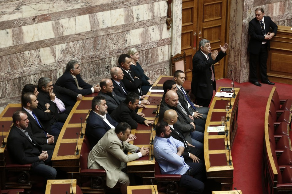 Leader of the extreme-right Golden Dawn party Mihaloliakos addresses parliamentarians during a parliament session