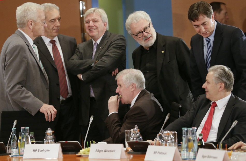 Bavarian state premier Seehofer eats a piece of cake before a meeting of federal state premiers with Chancellor Merkel