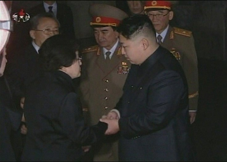 Kim Jung Un, flanked by generals, meets a subject