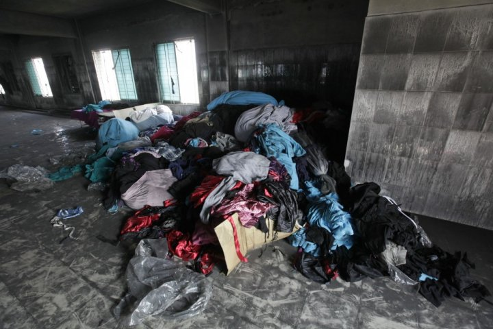 Clothes and sewing machines are seen in the Tazreen Fashions garment factory, where 112 workers died in a fire, in Savar