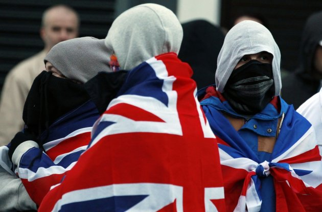 Loyalists protest outside the offices of a member of the Alliance Party in East Belfast (Reuters)