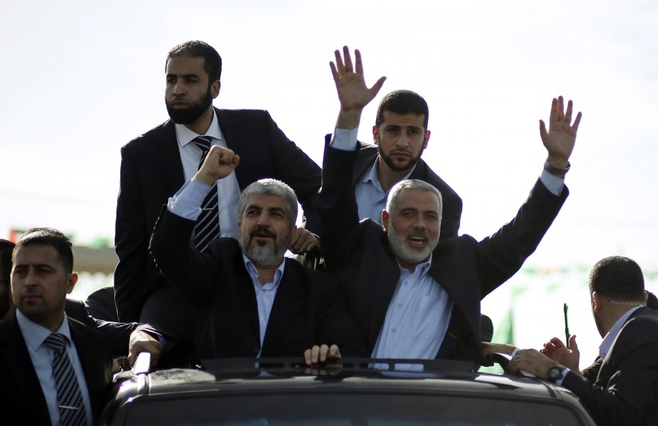 Hamas chief Khaled Meshaal and senior Hamas leader Ismail Haniyeh wave to the crowd upon Meshaals arrival in the southern Gaza Strip