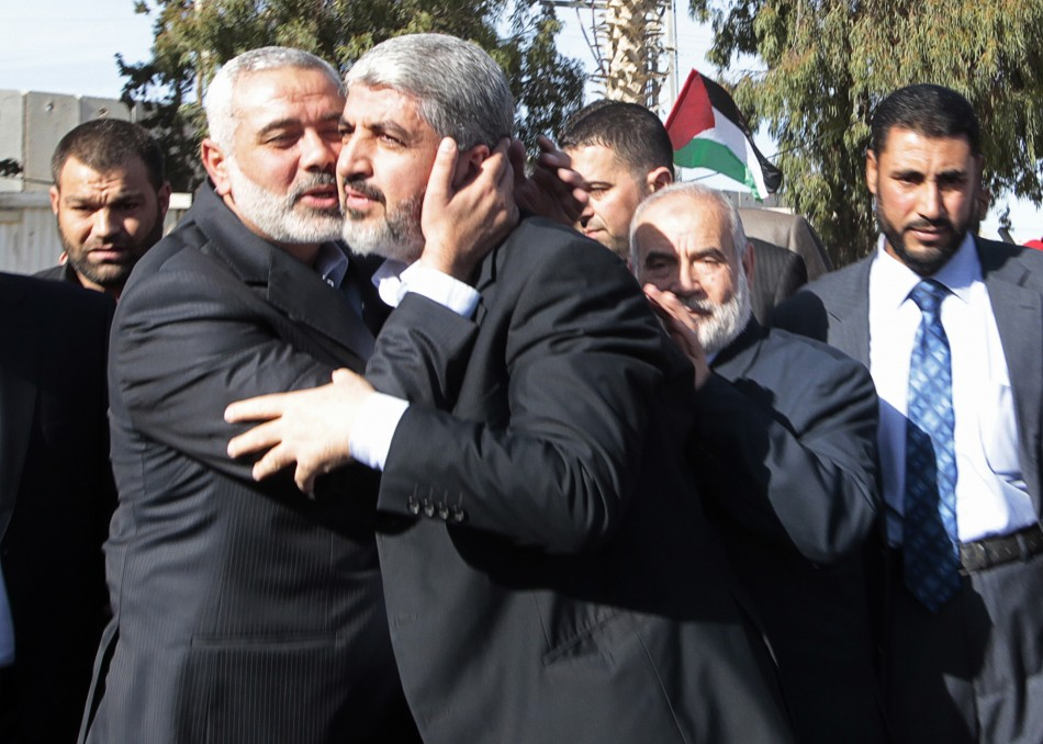 Senior Hamas leader Ismail Haniyeh kisses Hamas chief Khaled Meshaal upon Meshaals arrival at the Rafah crossing in the southern Gaza Strip