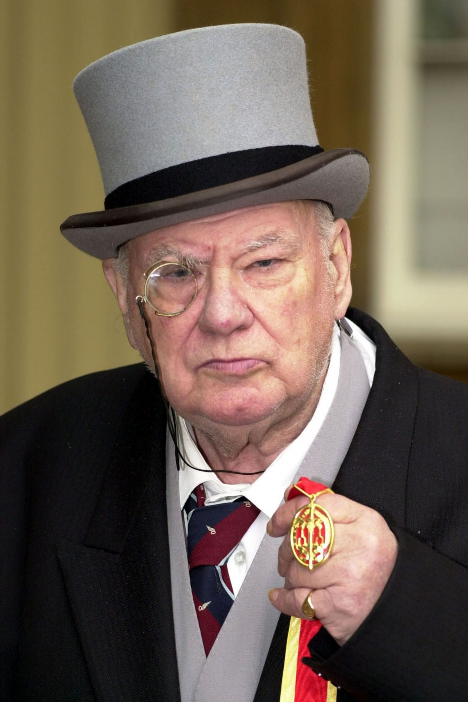 Astronomer Sir Patrick Moore with his knighthood that he received from The Prince of Wales at Buckingham Palace in London March 2, 2001 (Photo: Reuters)